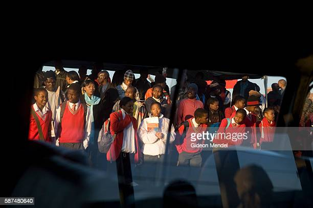 Pupils queue for transport at the Baragwanath taxi rank which will take them to their school outside of Soweto Many aspirant parents living in South...