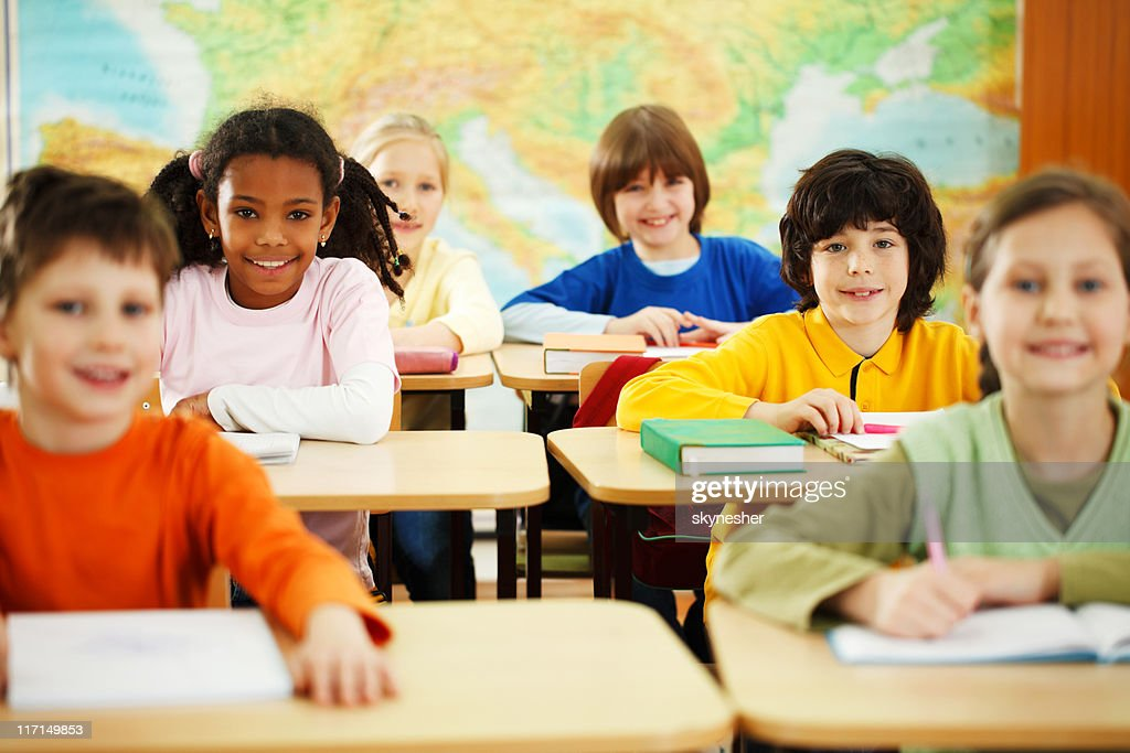 Pupils sitting in the classroom : Stock Photo