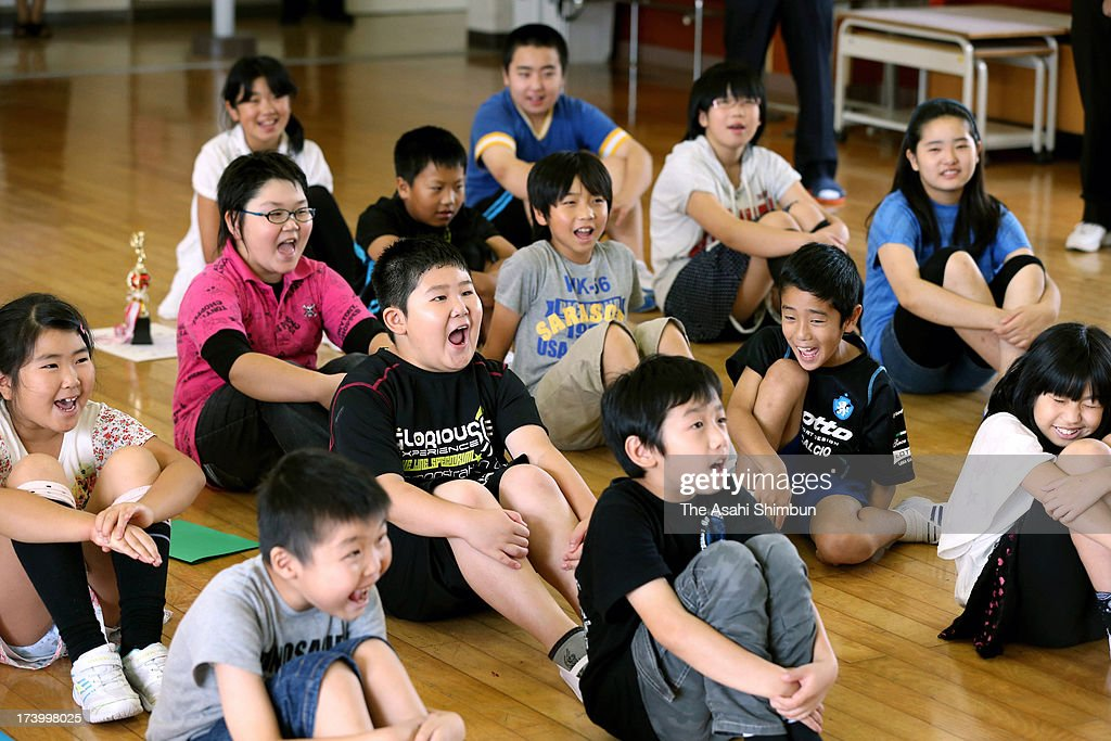 Pupils smile as they will enter one-month summer vacation at evacuated Namie Elementary School on July 19, 2013 in Nihonmatsu, Fukushima, Japan. The whole school has been evacuated from Namie town, where the school is only 9 kilometers from crippled Fukushima Daiichi Nuclear Power Plant. The school had no newcomers this year, only 19 pupils are studying, most of them are commuting from temporary housing.