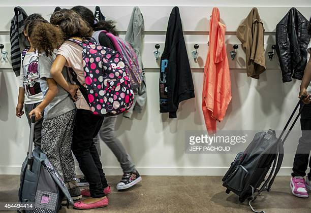 Pupils speak in the corridor of a elementary school prior to enter their classroom on September 2 2014 in Lyon on the first day of the French new...