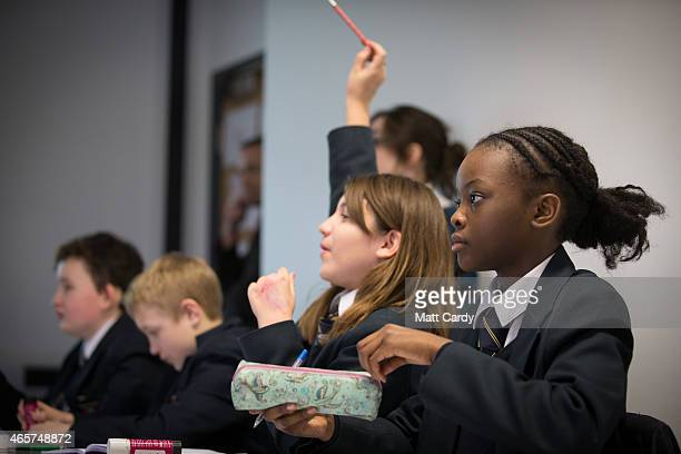 Pupils take part in a Spanish lesson at the Ridings Federation Winterbourne International Academy in Winterbourne near Bristol on February 26 2015 in...