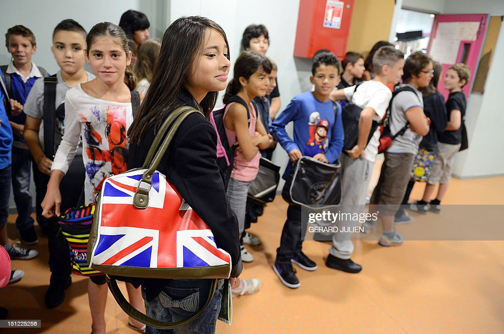 Pupils wait for the distribution of their schoolbooks on September 4, 2012, at the start of the new school year in Marseille, southeastern France.