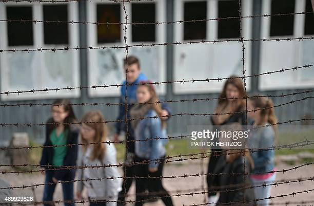 Pupils walk during a school visit inside the Struthof WWII concentration camp in Natzwiller eastern France the only Nazi death camp on French soil on...
