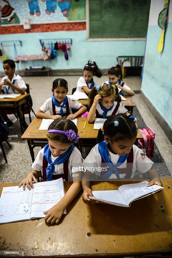 Pupils work during a class at a school in Havana on November 13, 2012.