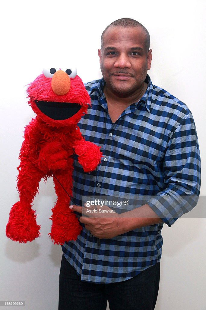 Puppeteer <a gi-track='captionPersonalityLinkClicked' href=/galleries/search?phrase=Kevin+Clash&family=editorial&specificpeople=653958 ng-click='$event.stopPropagation()'>Kevin Clash</a> poses for a portrait with Elmo at the Apple Store Upper West Side on November 20, 2011 in New York City.