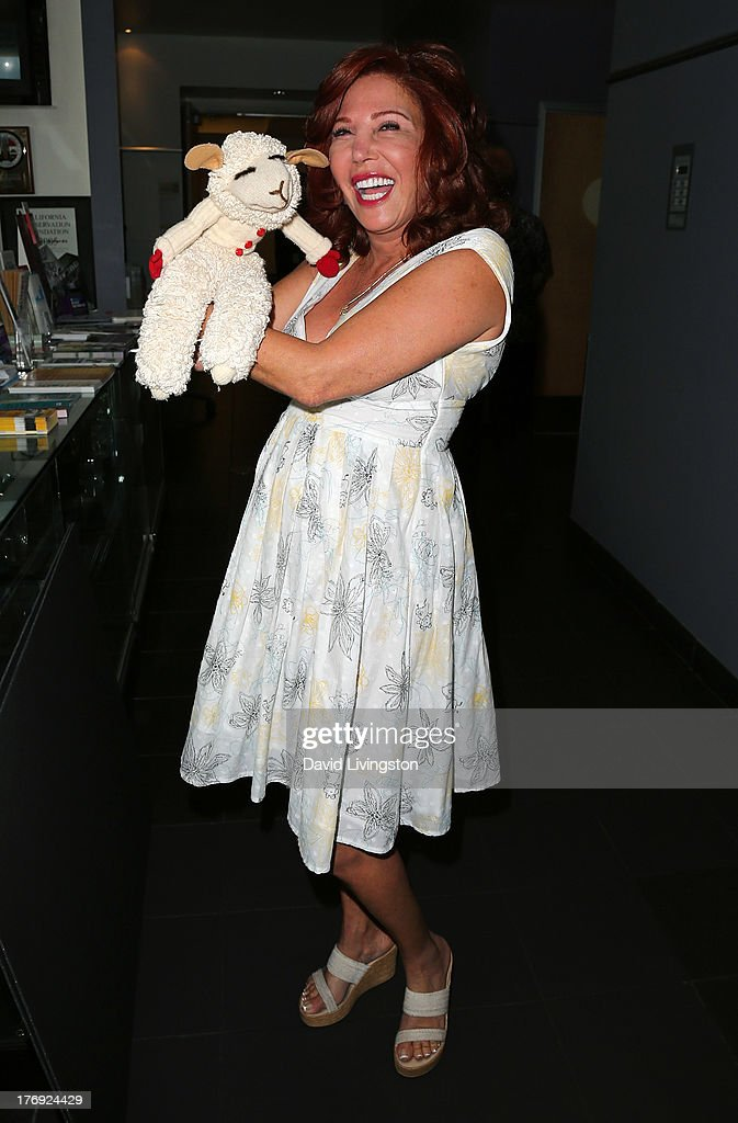 Puppeteer Mallory Lewis attends the unveiling of the new United States Postal Service special pictorial postmark featuring Helen Reddy on August 19, 2013 in West Hollywood, California.