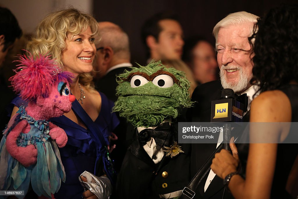 Puppeteers Caroll Spinney (R) and Leslie Carrara-Rudolph with Oscar the Grouch and Abby at The 39th Annual Daytime Emmy Awards broadcasted on HLN held at The Beverly Hilton Hotel on June 23, 2012 in Beverly Hills, California. (Photo by Christopher Polk/WireImage) 22542_003_CP_0200.JPG