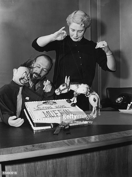 Puppeteers Jan Bussell and his wife Ann Hogarth celebrate the return to television of children's favourite Muffin the Mule at Television House London...