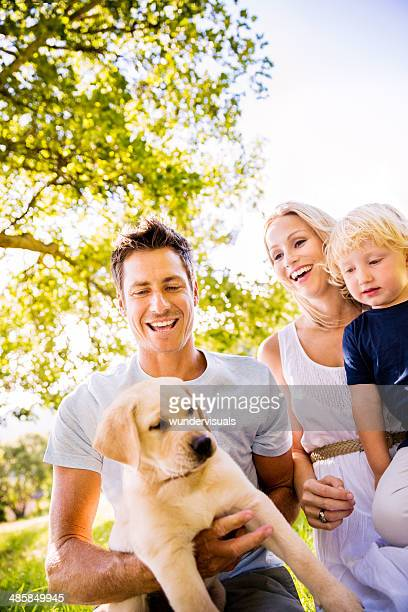 Puppy and his family in the park