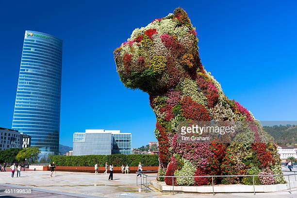 Puppy flower feature floral art in dog form by Jeff Koons at Guggenheim Museum Iberdrola Tower Bilbao Spain