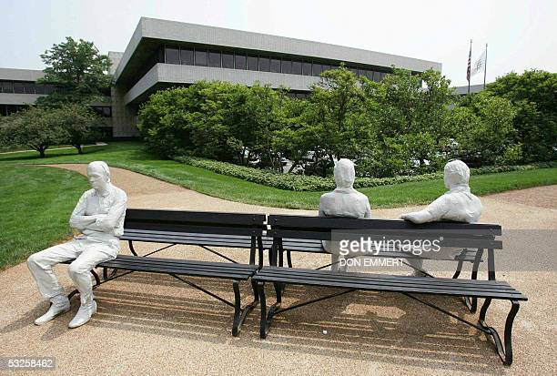 A sculpture called 'Three People on Four Benches' by George Segal sits in front of the Pepsico world headquarters 19 July 2005 in Purchase NY The...