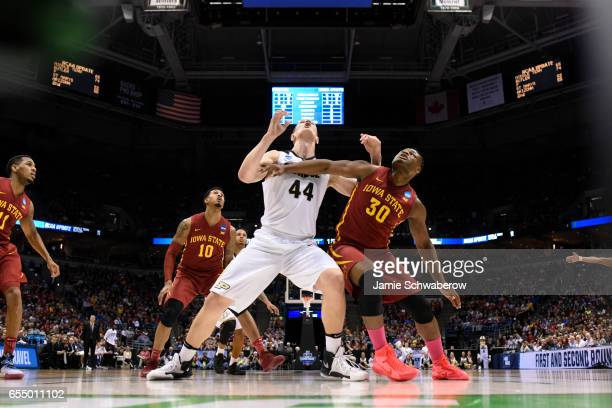 Purdue Boilermakers center Isaac Haas and Iowa State Cyclones guard Deonte Burton jostle for position during the 2017 NCAA Men's Basketball...