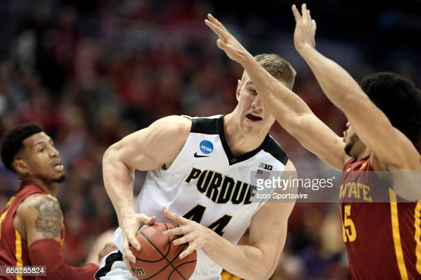 Purdue Boilermakers center Isaac Haas battles with Iowa State Cyclones forward Darrell Bowie and Iowa State Cyclones guard Nazareth MitrouLong in the...
