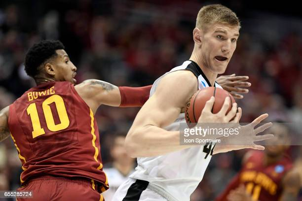 Purdue Boilermakers center Isaac Haas battles with Iowa State Cyclones forward Darrell Bowie in the second half during the first round of the 2017...