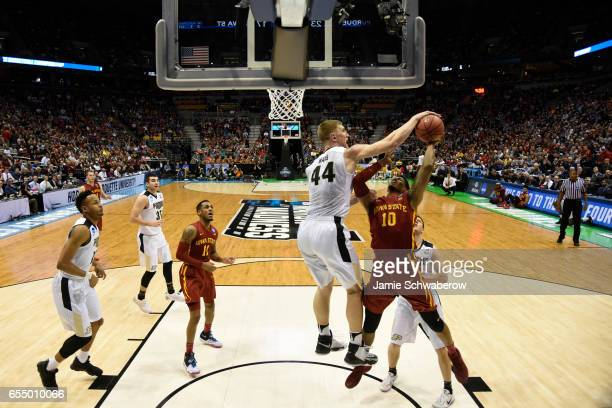 Purdue Boilermakers center Isaac Haas blocks the shot of Iowa State Cyclones forward Darrell Bowie during the 2017 NCAA Men's Basketball Tournament...
