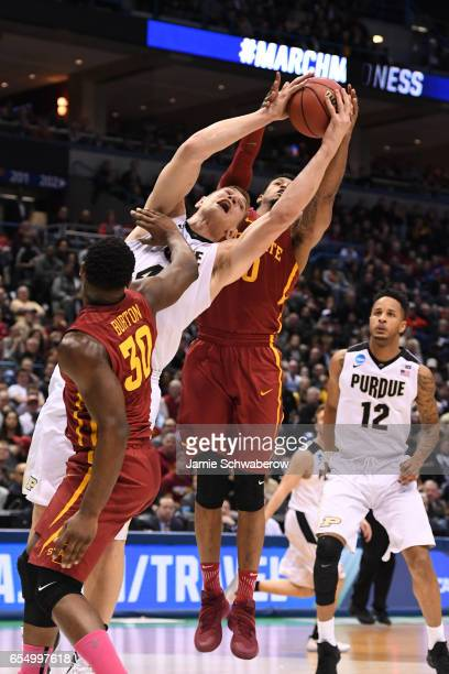 Purdue Boilermakers center Isaac Haas reaches up for a rebound during the second half of the 2017 NCAA Men's Basketball Tournament held at BMO Harris...