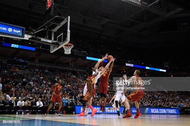 Purdue Boilermakers center Isaac Haas reaches up for a rebound during the first half of the 2017 NCAA Men's Basketball Tournament held at BMO Harris...