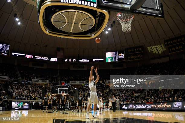 Purdue Boilermakers Center Isaac Haas shoots a free throw after a technical foul is called during the college basketball game between the Chicago...