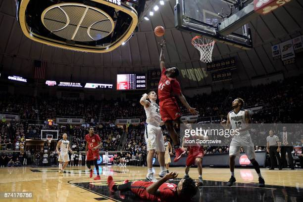 Purdue Boilermakers Center Isaac Haas shoots over Southern Illinois University Edwardsville Cougars forward Keenan Simmons during the college...
