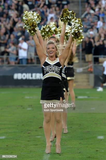 Purdue Boilermakers cheerleaders perform during a break in the Big Ten Conference game between the Minnesota Golden Gophers and the Purdue...