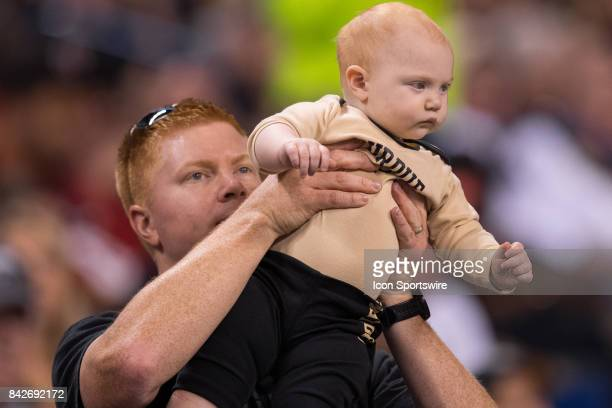 Purdue Boilermakers fan hold up his baby during the college football game between the Purdue Boilermakers and Louisville Cardinals on September 2 at...