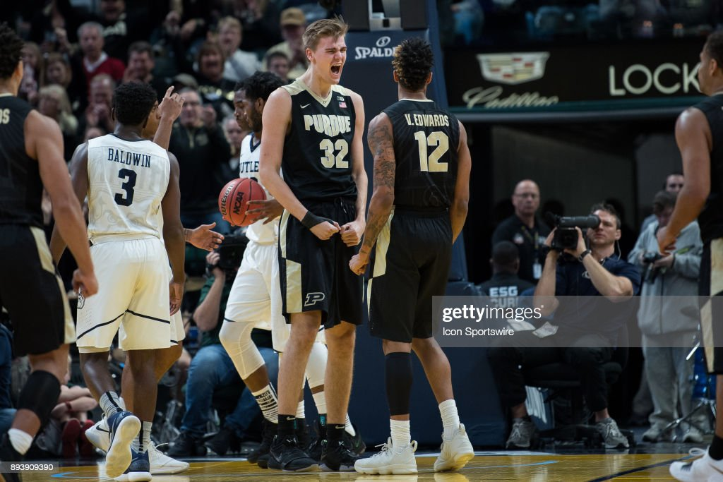 Purdue Boilermakers forward Matt Haarms (32) and Purdue Boilermakers forward Vincent Edwards (12) celebrate after a score during the Crossroads Classic basketball game between the Butler Bulldogs and Purdue Boilermakers on December 16, 2017, at Bankers Life Fieldhouse in Indianapolis, IN.