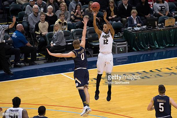 Purdue Boilermakers forward Vincent Edwards shoots a three pointer over Notre Dame Fighting Irish guard Rex Pflueger during the Crossroads Classic...