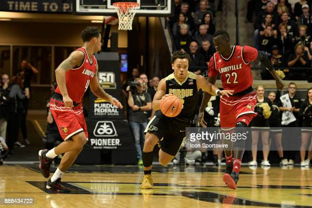 Purdue Boilermakers Guard Carsen Edwards brings the ball up the court on a fast break during the ACC/Big Ten Challenge basketball game between the...