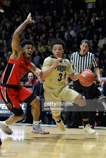 Purdue Boilermakers guard Carsen Edwards dribbles by Rutgers Scarlet Knights guard Corey Sanders during the Big Ten conference game on February 14 at...