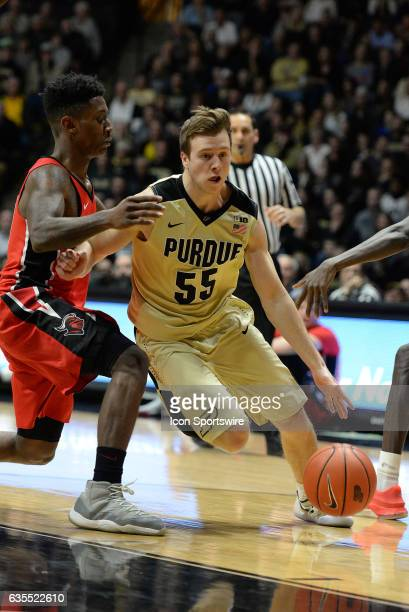 Purdue Boilermakers guard Spike Albrecht dribbles by Rutgers Scarlet Knights guard Corey Sanders during the Big Ten conference game on February 14 at...