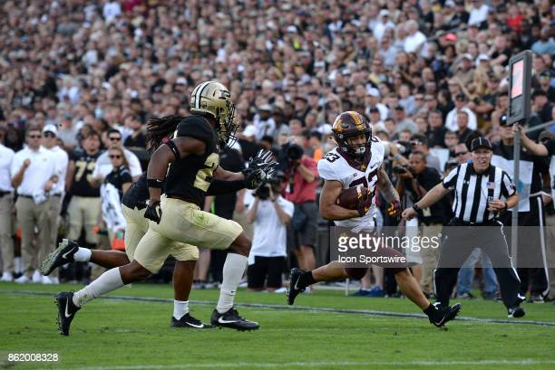 Purdue Boilermakers linebacker TJ McCollum and Purdue Boilermakers safety Navon Mosley try to push Minnesota Golden Gophers running back Shannon...