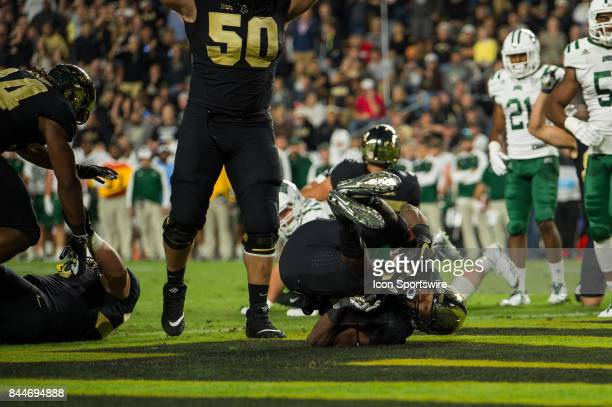 Purdue Boilermakers running back Tario Fuller rolls into the end zone for a 1yard touchdown during the college football game between the Purdue...