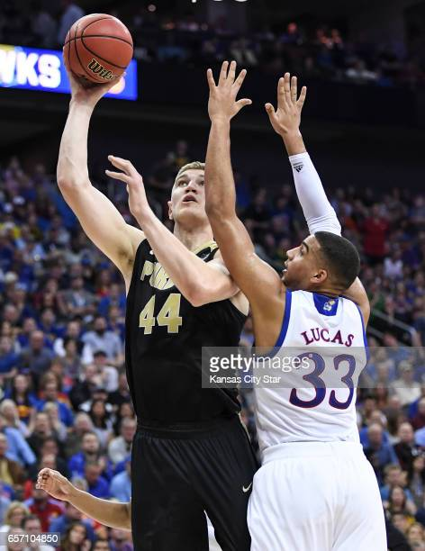 Purdue center Isaac Haas shoots against Kansas forward Landen Lucas in the first half during the Sweet Sixteen round of the NCAA Tournament at Sprint...