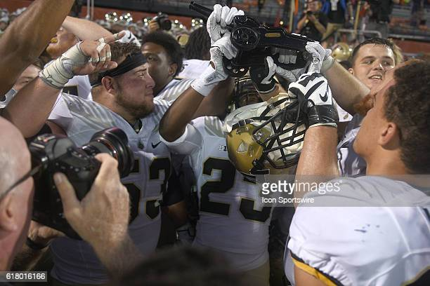 Purdue players celebrate with the Cannon trophy after a Big Ten Conference football game between the Purdue Boilermakers and the Illinois Fighting...