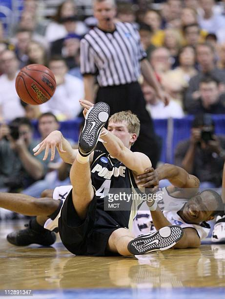 Purdue's Robbie Hummel passes the ball as Xavier's BJ Raymond battles for possession in first half action The Purdue Boilermakers faced the Xavier...
