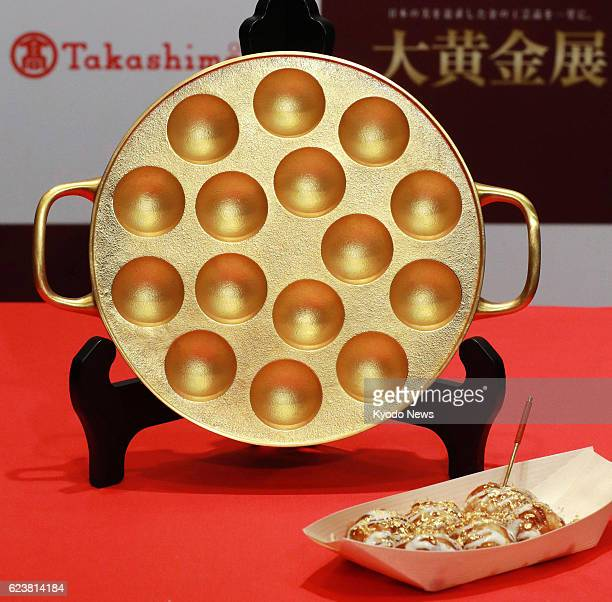 A pure gold 'takoyaki' dumpling maker and toothpick are on display on Nov 17 at Takashimaya Co department store in the western Japan city of Osaka...