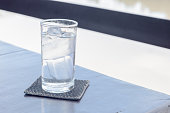 pure water with ice in glass on table