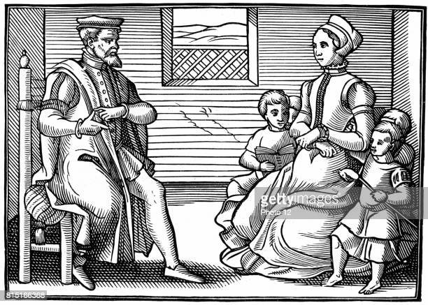 A Puritan Family Father teaching his family to sing Psalms rather than 'vayne and tryflying ballades' From the position of his hands it seems he is...
