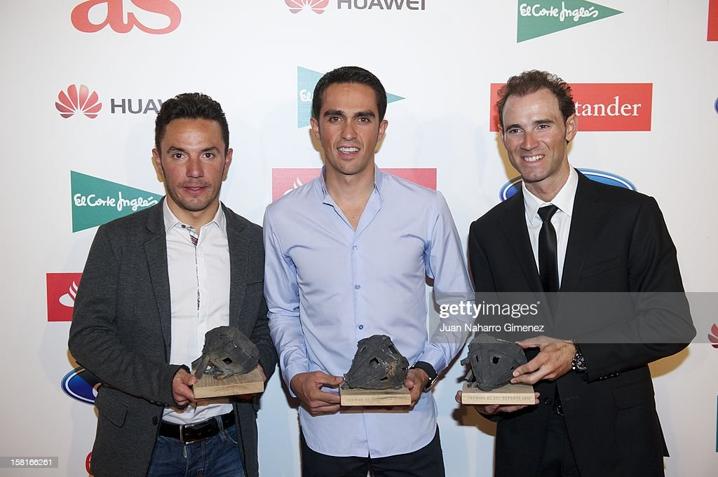 Purito Rodriguez, Alberto Contador and Alejandro Valverde attend 'As del Deporte' awards 2012 at Palace Hotel on December 10, 2012 in Madrid, Spain.