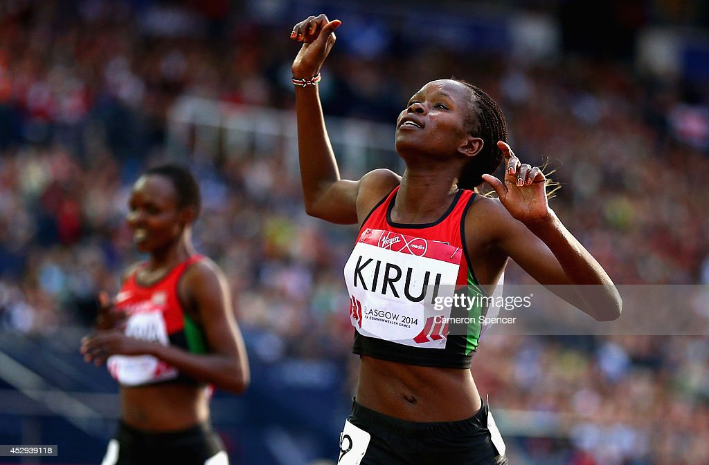 Purity Kirui of Kenya crosses the line to win gold in the Women's 3000 metres Steeplechase at Hampden Park during day seven of the Glasgow 2014 Commonwealth Games on July 30, 2014 in Glasgow, United Kingdom.