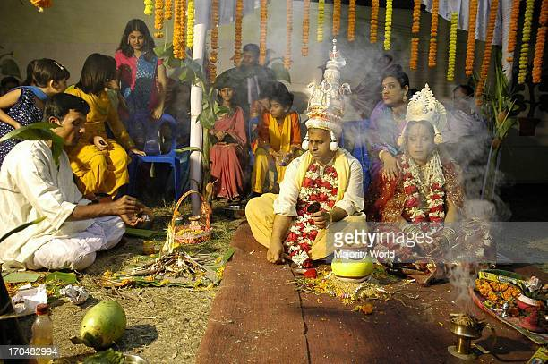 A purohit is conducting the rituals of a Hindu wedding ceremony at old Dhaka Bangladesh February 3 2006