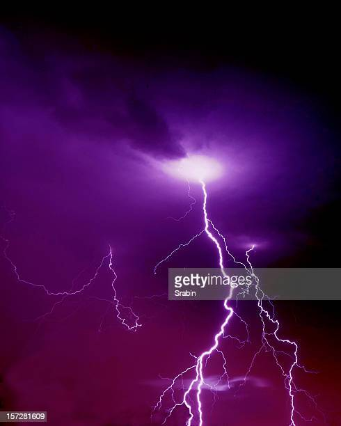 Purple and pink sky with lightning striking