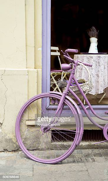 Purple bike in front of old building