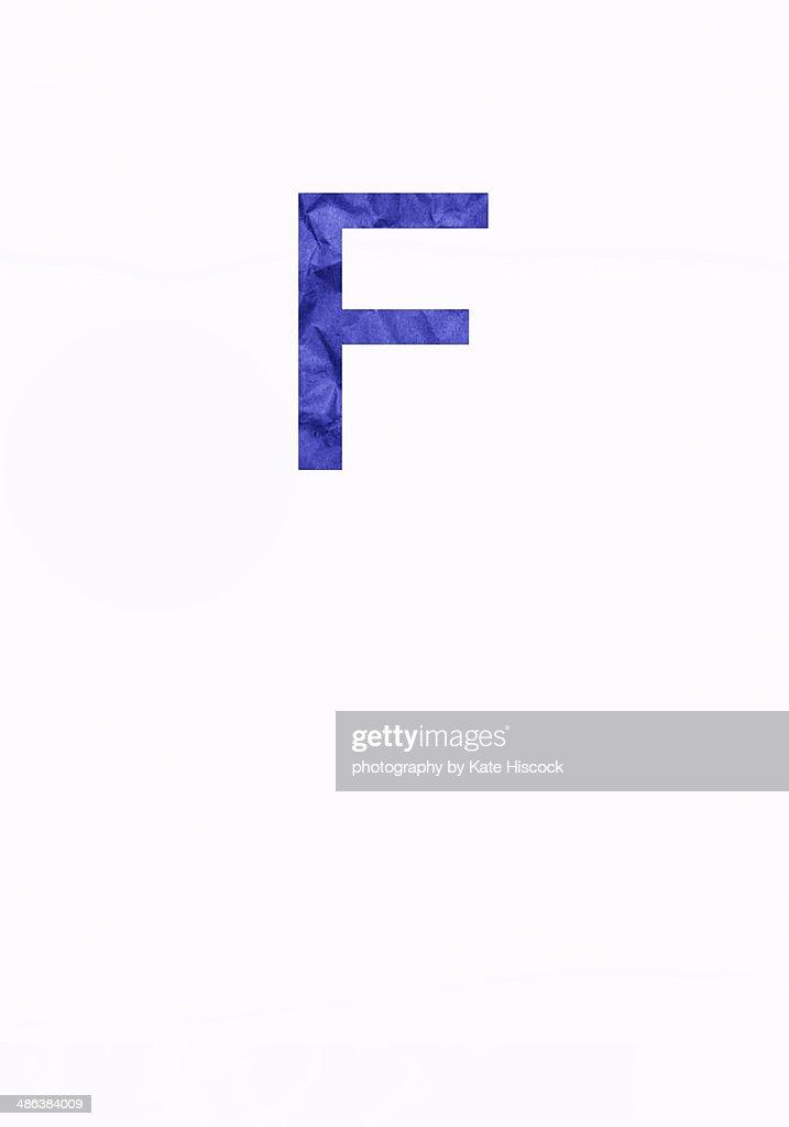 Purple capital letter F - paper cut