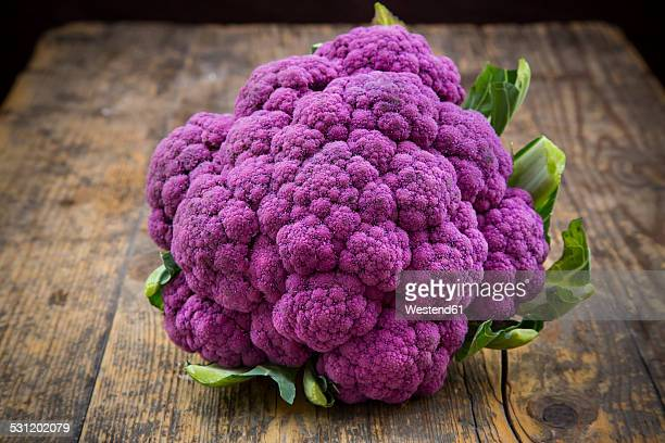 Purple cauliflower on wood