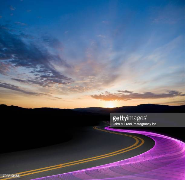 Purple data waves flowing on information superhighway at sunset