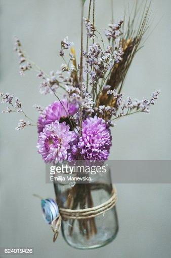 Purple flowers in jar