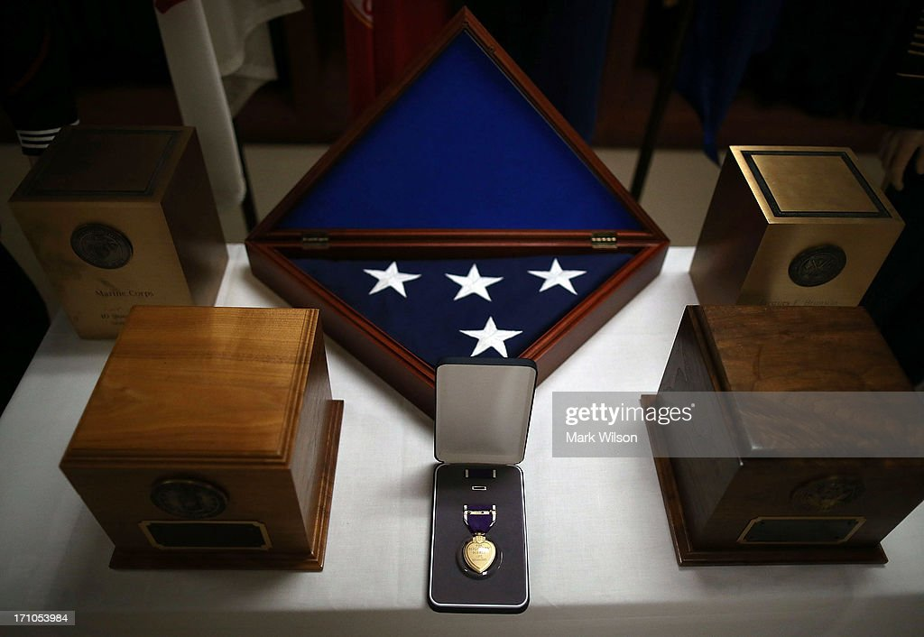A Purple Heart medal and various urn's are on display in the uniform preparation shop at Dover Air Force Base Mortuary Affairs operations complex, June 21, 2013 in Dover, Delaware. Since the 1950s fallen members of the military fighting in conflicts aboard are brought to Dover's Air Force Mortuary Affairs operations complex which is the Defense Departments largest joint service mortuary facility in the United States.