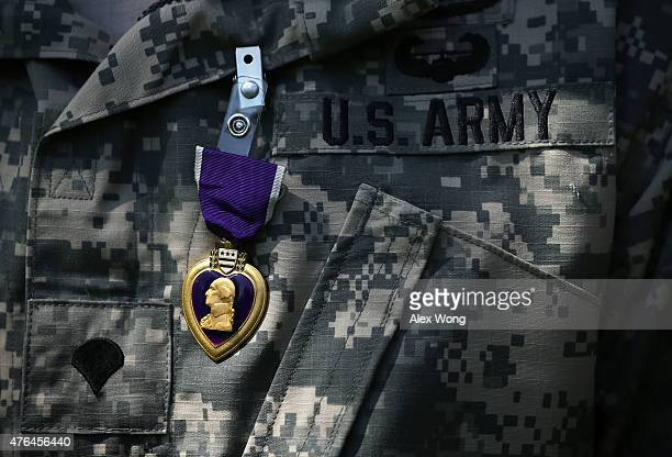 Purple Heart medal is seen pinned on a recipient's uniform during a Purple Heart ceremony June 9 2015 at George Washington's Mount Vernon in Mount...