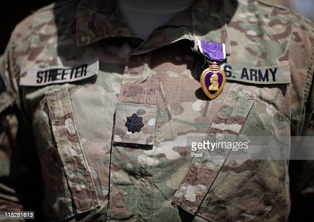 Purple Heart medal is shown on the uniform of US Army Lt Colonel Alan Streeter after US Secretary of Defense Robert Gates presented the award for...